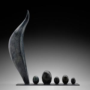 Abstract bronze sculpture. Title: Alma Mater