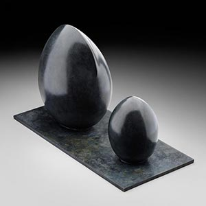Abstract bronze sculpture. Title: Genèse
