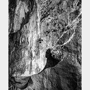 Black and white photograph of caves in the Greek island of Kithira inspired by the writings of the ancient Greek philosopher Heraclitus. Title: Homage to Heraclitus: Earth I