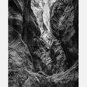 Black and white photograph of caves in the Greek island of Kithira inspired by the writings of the ancient Greek philosopher Heraclitus. Title: Homage to Heraclitus: Earth III