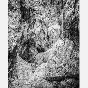 Black and white photograph of caves in the Greek island of Kithira inspired by the writings of the ancient Greek philosopher Heraclitus. Title: Homage to Heraclitus: Earth IV
