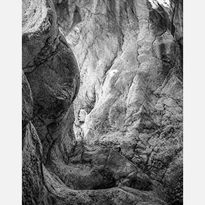 Black and white photograph of caves in the Greek island of Kithira inspired by the writings of the ancient Greek philosopher Heraclitus. Title: Homage to Heraclitus: Earth V