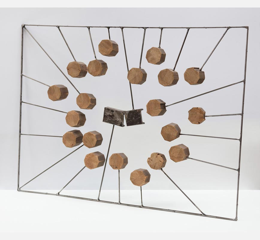 Abstract metal and wood sculpture. Title: Inclusion I